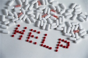 'Help' written in pills.
